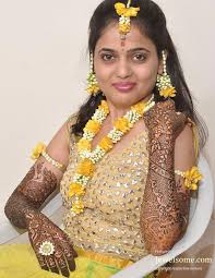 Yellow and white fresh flower jewellery for marriage function
