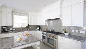 white cabinets grey glass backsplash and med grey granite with