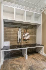 entryway mudroom khaki toned wall tile halsted glass subway