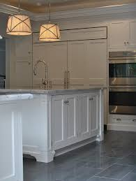 kitchen with gray staggered tile floor transitional kitchen