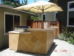 Awesome Small Backyard Kitchen Design With L Shaped Island Breakfast Bar Also Diamond Pattern Travertine