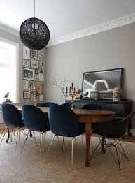 Chic Eclectic Dining Room With Lovely Grey Walls Blue Velvet Upholstered Chairs And A Wood Oval Table