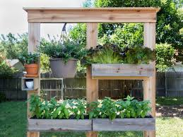 Make A DIY Privacy Screen And Planter | HGTV Ideas For Outdoor Privacy Screens Green Grass Extra Wide Back Garden Ideas 2833 Hostelgardennet 11 Ways To Create A More Relaxing Backyard Patio Spanish Style Cover Designs Choosing Bold Color Your Shed Old Brand New The Growers Daughter Front Yard Landscape Ask The Expert How Use Plants In City Garden Audzipan Anthology Pergola Oakley Our Land Organics With Trellis Better Homes And Gardens Best 25 Cheap Fence On Pinterest Panels