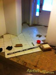 How to Install Tile Floor to an Entryway
