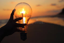 holding a electric light bulb stock image image 78965789