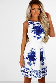 makes me wonder white and blue floral skater dress pink boutique