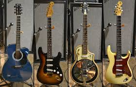 Left To Right Martin Kenny Wayne Shepherd Signature Acoustic Prototype Fender Stevie Ray Vaughan Strat With GraphTech Saddles And A Custom Neck