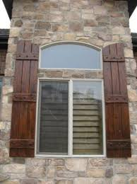 Rustic Knotty Alder Exterior Shutters 3 Plank Arched