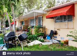 Miami Florida Little Havana House Yard Trash Neglected Exterior ... Chaos Untidy Dorganised Mess Lazy Garden Backyard Junk Rubbish Outdoor Removal 4 Good Edmton Forgotten Yard Microvoltssurge Wiki Fandom Powered By Wikia The Backyard Garden Gets Jifiedfunky Interiors Best Creative Ideas On Pinterest Diy Decor And Chairs Junk Items Vegetable Gardening In A Small 2054 Call 2 Haul Allentown Pa Handpainted Upcycled Art From An Exhibit At The Nc State Sebastopols Quirky Sculptures A Photo Essay