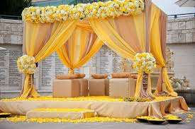 Outdoor Indian Wedding Decorations With Cube Ottomans And Small Pillows Also Yellow Cream Curtains