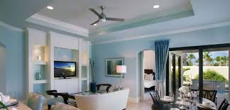 light blue living dining room with ceiling fan interior design