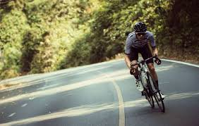 Cyclist Sprinting Up A Road