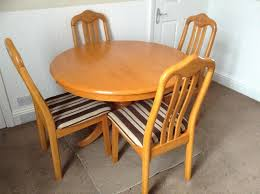 A Wooden Round Dining Table With Four ChairsVery Good Condition Top Screws Off From Pedestal For EasyTransportAdjustable Feet Levelling