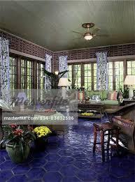 sunrooms cobalt blue hexagon tile floor brick walls floral