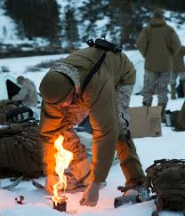 A US Marine With Combat Logistics Battalion 26 2nd Group Ignites His