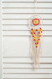 Rustic Dream Catcher With Red And Yellow Wooden Beads In The Interior Toys Letters
