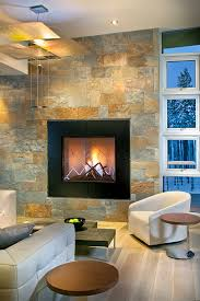 stone veneer fireplace Living Room Contemporary with armchair