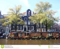 100 Boat Homes Flower Laden House Against Backdrop Of Amsterdam Gables