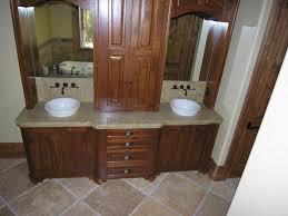 brown wooden bathroom double vanity having marble top and double