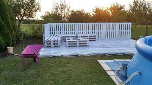 Then They Created A Fence Behind The Pallets On Ground Reinforced With Steel Beams And Pallet Pool Deck Ideas Diy