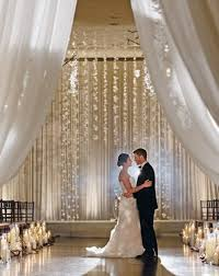 Indoor Wedding Ceremony Elegant Arch Decorations Created Out Of Hanging Flower Cascade In Graduated Lengths