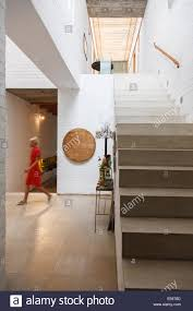 Woman Walking By Doorway In Modern House