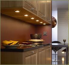 kitchen warm cabinet lighting design with white tile wall