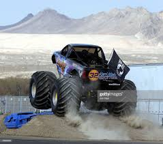 Karl Malone Of The Utah Jazz Drives The Monster Truck That He ...