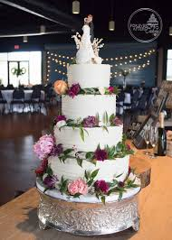 Shabby Chic Wedding Cake With Textured Buttercream Ruffle And Scattered Flowers
