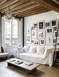Chic Living Room With Exposed Beams A Large Gallery Wall White Sofa