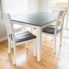 Dining Table With Grey Wood Stained Top And White Legs