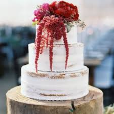 Rustic Rough Frosted Wedding Cake With Crimson Flowers