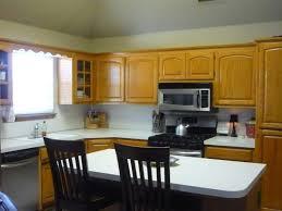 Kitchen Backsplash Ideas With Dark Wood Cabinets by Kitchen Backsplashes Barstools And Wood Countertops With Oak