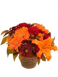 Rustic Orange And Cranberry Flower Arrangement
