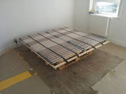 Pallet Bed Frame by Lonset Bed Slats Paired With Pallets For A Cheap Diy Bed Ikea