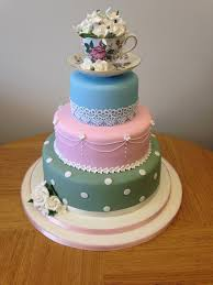 3 Tier Vintage Style Wedding Cake With Tea Cup As Topper Filled Roses