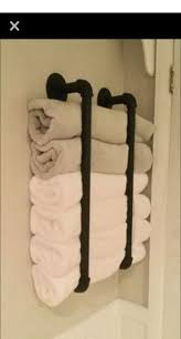 gerollte handtücher aufbewahrungsmöbel ideen storage