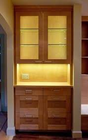 led lights accent the cabinets within and display above this
