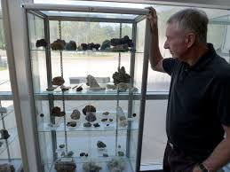 Mike Patrick 66 Examines A Display Case Filled With Sulfate Minerals Obtained