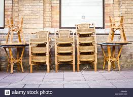 Stacked Tables And Chairs Outside A Cafe In A Town Stock Photo ... Chairs And Tables The Home Of Truth Stack On Table Clipart Free Clip Art Images 21722 Kee Square Chrome Breakroom 4 Restaurant The 50 From Restoration Hdware New York Times Kobe 72w X 24d Flip Top Laminate Mobile Traing With 2 M Cherry Finish And Burgundy Lifetime 5piece Blue White Childrens Chair Set 80553 Lanzavecchia Wai Collection Includes Hamburger Tables Starsky Stack Table Rattan Of 3 45 Round Adjustable Plastic Activity School
