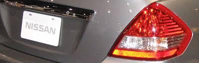 replace the brake light bulbs on a nissan versa