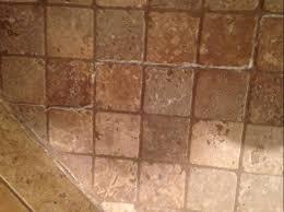 how do i remove stubborn white residue travertine shower floor