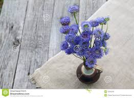Rustic Still Life With A Bouquet Of Blue Flowers On Wooden Bac