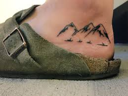 Small And Simple Mountains Foot Tattoo