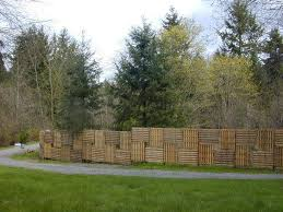 8 Tall Fence Made From Roofing Pallets