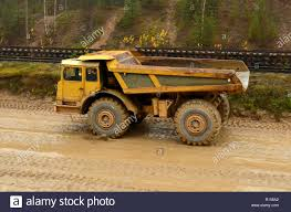 100 Earth Mover Truck Mover Loading Dumper Truck With Sand In Quarry Excavator