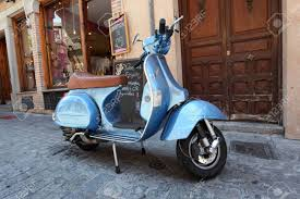 Classic Italian Vespa Scooter In The Old Town Of Toledo Spain Stock Photo