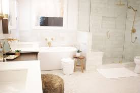 oval freestanding tub with brass wall mount tub filler