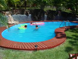 Backyard Swimming Pool For Your Home Designs — Home Landscapings Decorating Attractive Above Ground Pool Deck For Enjoyable Home Good Picture Of Backyard Landscaping Decoration Using White Latest Ideas On Design Inspiring And 40 Uniquely Awesome Pools With Decks Pools Beautiful Oval Designs Gardens Geek Modern Image Solid Above Ground Pool Landscaping Ideas Swimming Spa Best And Emerson