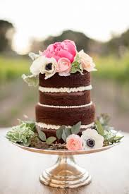 small chocolate cake silver stand pink flowers